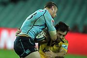 Rob Horne runs in to Conrad Smth. Waratahs v Hurricanes. 2012 Super Rugby round 15 match. Allianz Stadium, Sydney Australia on Saturday 2 June 2012. Photo: Clay Cross / photosport.co.nz