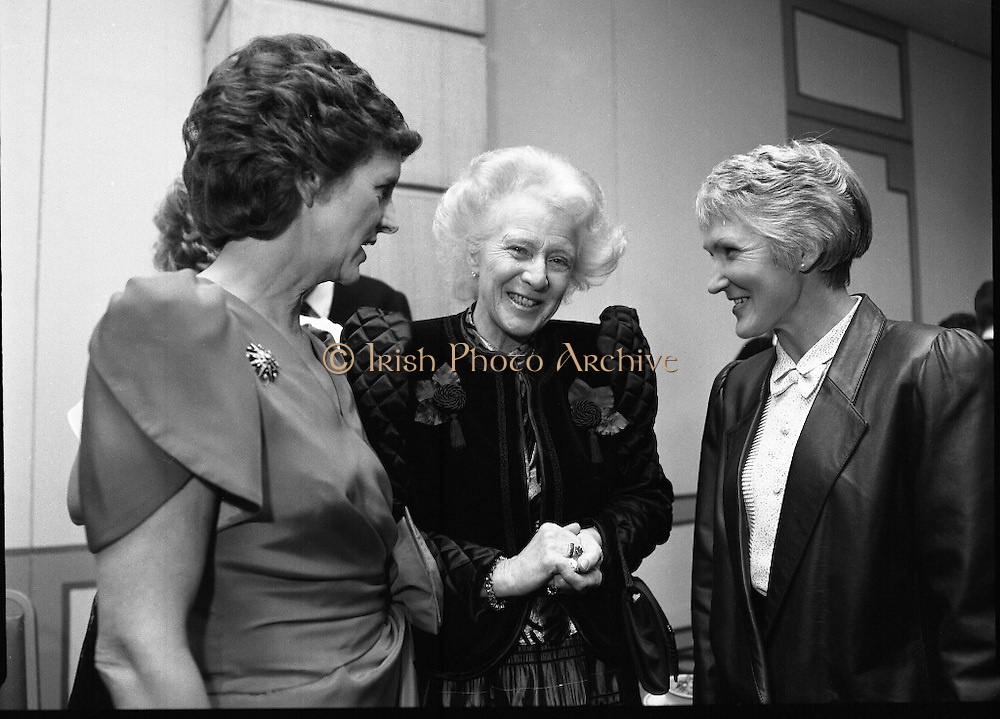 People Of The Year Awards.  (R91)..1988..22.11.1988..11.22.1988..22nd November 1988..This is the fourteenth year of the People of the Year Awards, sponsored by the New Ireland Assurance Company plc. The awards will be presented by Mr Ray Burke TD, Minister of Energy and Communications. Eight people have been nominated this year..Mr Ollie Jennings, for his contribution to community and cultural life of Galway City..Mr Jack Charlton, for restoration of pride to the Irish Soccer team..Ms Carmencita Hederman, For her efforts to instill a community spirit in Dublin..Maureen O'Mahony, for her dedication in assisting the sick and elderly in the Bantry area..Mr Tommy Boyle, for his contribution in having the Garda band ranked as one of the top bands in the world..Ms Alice Leahy, for a lifetime commitment in providing medical care to the Dublin Homeless..Ms Norma Smurfitt, for her voluntary contribution to the work of the Arthritis Foundation Of ireland..Mr Gordon Wilson, for his commitment to peace and reconcilliation in Northern Ireland...Mrs Mave Hillery, wife of the President, is pictured congratulating Ms Carmencita Hederman and Ms Alice Leahy at the awards ceremony.