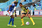 Joe Widdowson takes on Alexander McQueen during the Sky Bet League 2 match between Carlisle United and Dagenham and Redbridge at Brunton Park, Carlisle, England on 12 September 2015. Photo by Craig McAllister.