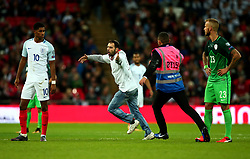 An England fan runs onto the pitch during the game with Slovenia at Wembley - Mandatory by-line: Robbie Stephenson/JMP - 05/10/2017 - FOOTBALL - Wembley Stadium - London, United Kingdom - England v Slovenia - World Cup qualifier