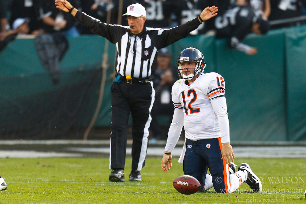 Nov 27, 2011; Oakland, CA, USA; Chicago Bears quarterback Caleb Hanie (12) reacts after being sacked by Oakland Raiders strong safety Tyvon Branch (not pictured) during the third quarter at O.co Coliseum. Oakland defeated Chicago 25-20. Mandatory Credit: Jason O. Watson-US PRESSWIRE