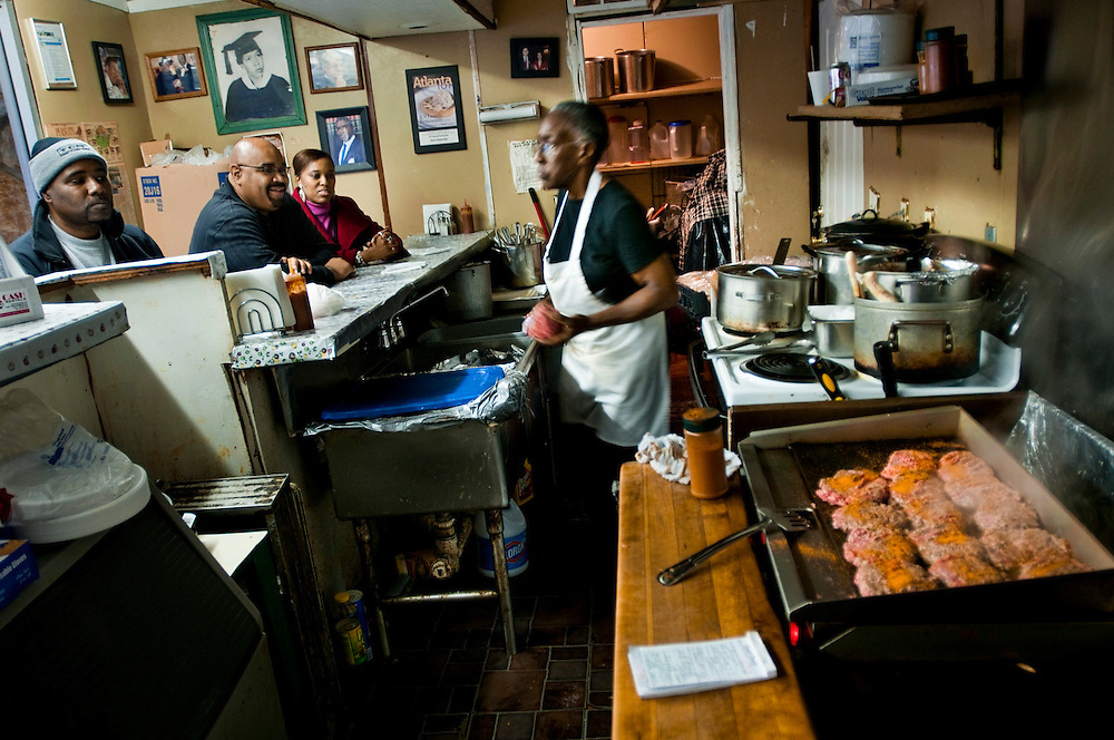 "Miss Ann making patties for her hamburgers, while guests are waiting for their orders...Ann's Snack Bar in the Atlanta neighborhood Kirkwood..The small restaurant is owned and operated by Ann Price, known to patrons as ""Miss Ann"" and has been in operation since 1973.  The house special is called the ""Ghetto Burger"", a double bacon chili cheeseburger with a secret ingredient.Wall Street Journal named the Ghetto Burger the best hamburger in America."