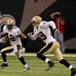 2009 September 13: New Orleans Saints safety Darren Sharper (42) runs back and interception as teammate safety Chris Reis (39) blocks downfield during a 45-27 win by the New Orleans Saints over the Detroit Lions at the Louisiana Superdome in New Orleans, Louisiana.