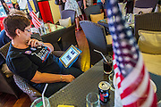 07 NOVEMBER 2012 - BANGKOK, THAILAND:   A member of Democrats Abroad use an iPad to monitor election results at the Democrats Abroad election watch party in Bangkok. US President Barack Obama won a second term Tuesday when he defeated Republican Mitt Romney. Preliminary tallies gave the President more than 300 electoral votes, well over the 270 needed to win. The election in the United States was closely watched in Thailand, which historically has very close ties with the United States. The American Embassy in Bangkok sponsored an election watching event which drew thousands to a downtown Bangkok hotel. American Democrats in Bangkok had their own election watch party at a restaurant in Bangkok.     PHOTO BY JACK KURTZ