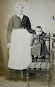 posed portrait of adult woman with little child late 1800s