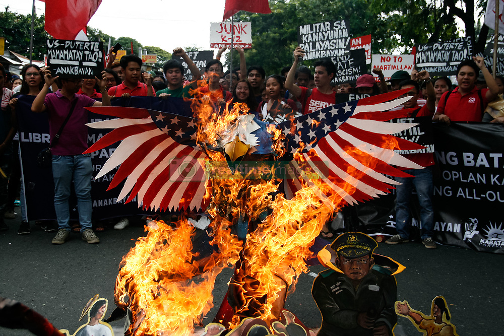 July 24, 2017 - Quezon City, Philippines - An eagle, which symbolizes the U.S. was burned near the House of Representatives in Quezon City. The protesters aired their dismay during President Duterte's second State of the Nation Address. The protesters also called for the end of Martial Law in Mindanao, and the end of drug related killings in the country. (Credit Image: © J Gerard Seguia via ZUMA Wire)