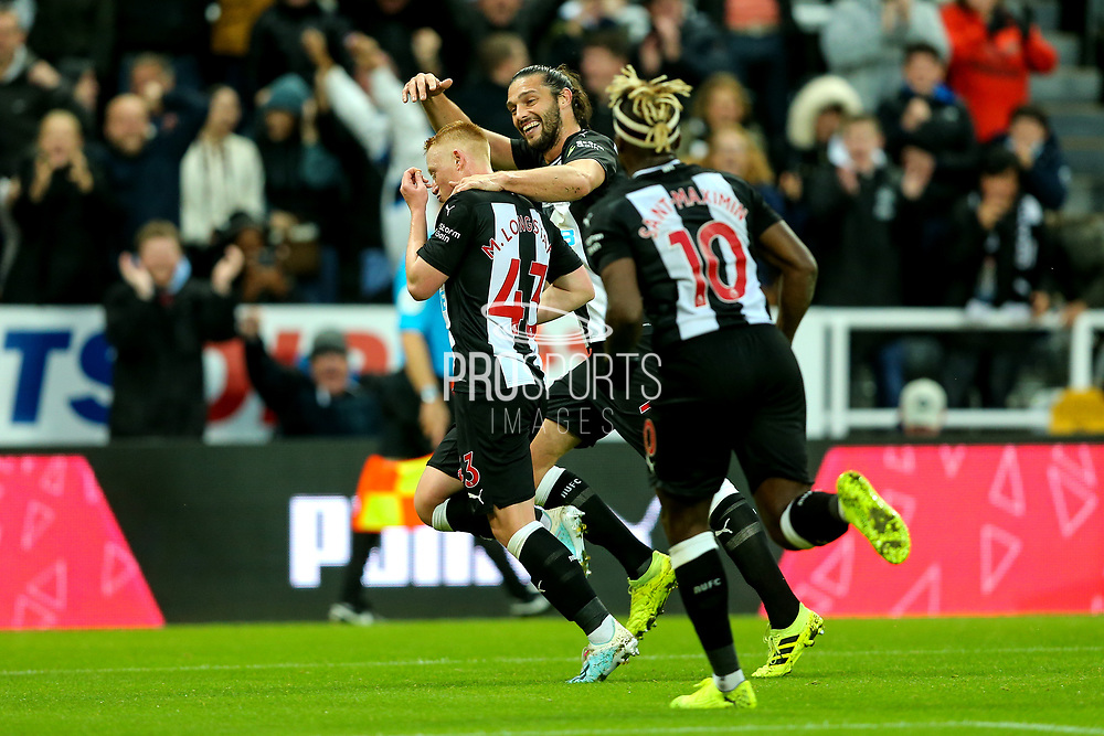 Matthew Longstaff (#43) of Newcastle United celebrates Newcastle United's first goal (1-0) wuth Andy Carroll (#7) of Newcastle United during the Premier League match between Newcastle United and Manchester United at St. James's Park, Newcastle, England on 6 October 2019.