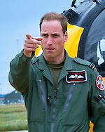 """PRINCE CHARLES MEETS SON PRINCE WILLIAM.The Prince of Wales visiting C Flight 22 Squadron at Royal Air Force Valley was shown a Sea King helicopter and around the flight where he works as a full time Seaking pilot on the RAF SAR team by his son The Duke of Cambridge Flt Lt Wales,Angelsey_9/7/2012.Mandatory Credit Photo: ©Faye Storer/NEWSPIX INTERNATIONAL..**ALL FEES PAYABLE TO: """"NEWSPIX INTERNATIONAL""""**..IMMEDIATE CONFIRMATION OF USAGE REQUIRED:.Newspix International, 31 Chinnery Hill, Bishop's Stortford, ENGLAND CM23 3PS.Tel:+441279 324672  ; Fax: +441279656877.Mobile:  07775681153.e-mail: info@newspixinternational.co.uk"""