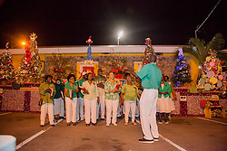 A Christmas selection is sung by Voices of Love.  Frenchtown Civic Organization/French Heritage Museum presents its 3rd Annual Festival of Lights Christmas Tree Competition in Frenchtown.  St. Thomas, USVI.  11 December 2016.  © Aisha-Zakiya Boyd