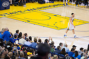 Fans cheer for Golden State Warriors guard Klay Thompson (11) after a made basket against the Philadelphia 76ers at Oracle Arena in Oakland, Calif., on March 14, 2017. (Stan Olszewski/Special to S.F. Examiner)
