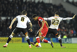 Korey Smith of Bristol City is tackled by Thomas Ince of Derby County - Mandatory byline: Dougie Allward/JMP - 15/12/2015 - Football - iPro Stadium - Derby, England - Derby County v Bristol City - Sky Bet Championship