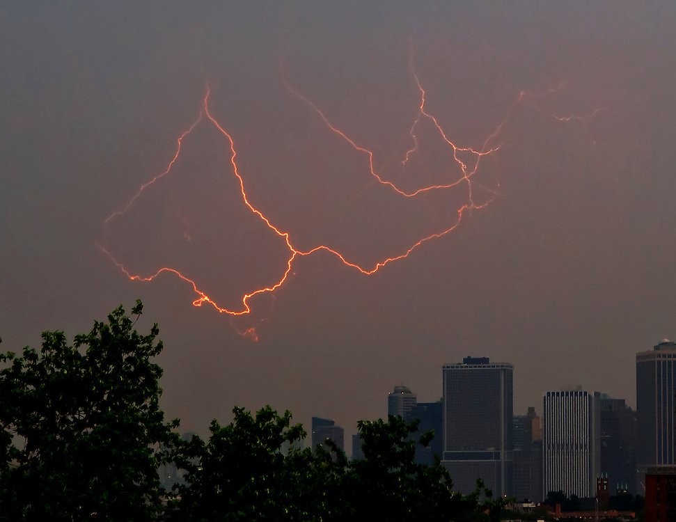 Lightning over lower Manhattan as seen from Brooklyn. The Trade Centers used to be right in the center of this shot.