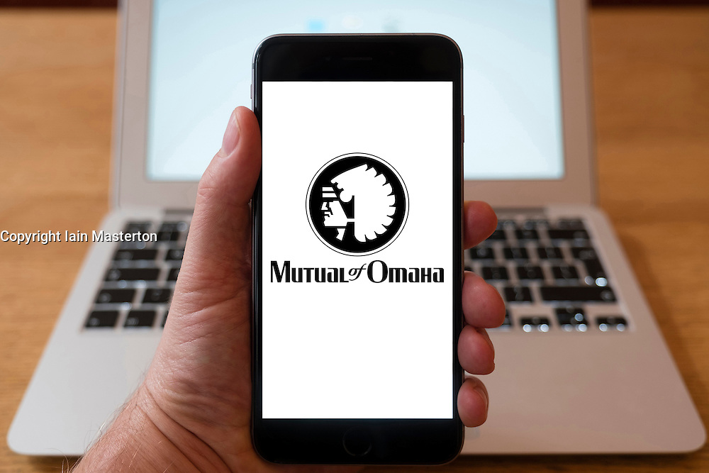 Using iPhone smartphone to display logo of Mutual of Omaha the mutual insurance and financial services company