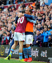 Aston Villa's Jack Grealish celebrates with Aston Villa's Gabriel Agbonlahor after playing his part in the opening goal for Aston Villa  - Photo mandatory by-line: Joe Meredith/JMP - Mobile: 07966 386802 - 09/05/2015 - SPORT - Football - Birmingham - Villa Park - Aston Villa v West Ham United - Barclays Premier League