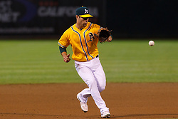 June 29, 2011; Oakland, CA, USA; Oakland Athletics third baseman Scott Sizemore (29) fields a ground ball against the Florida Marlins during the ninth inning at the O.co Coliseum.  Florida defeated Oakland 3-0.
