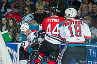 KELOWNA, CANADA - APRIL 8: Keoni Texeira #44 of the Portland Winterhawks gets caught up at the boards between Rodney Southam #17 and Carsen Twarynski #18 of the Kelowna Rockets on April 8, 2017 at Prospera Place in Kelowna, British Columbia, Canada.  (Photo by Marissa Baecker/Shoot the Breeze)  *** Local Caption ***