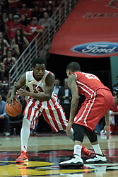 15 February 2014:  Daishon Knight held at half court by Walt Lemon, Jr. during an NCAA Missouri Valley Conference (MVC) mens basketball game between the Bradley Braves and the Illinois State Redbirds  in Redbird Arena, Normal IL.