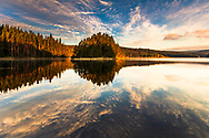 Reflections of clouds in the calm lake surface