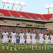 Members of the USA national soccer team stand in attention prior to a CONCACAF Gold Cup soccer match between the United States and Panama on Saturday, June 11, 2011, at Raymond James Stadium in Tampa, Fla. (AP Photo/Alex Menendez)