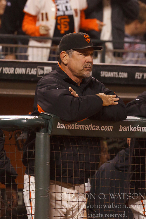 Sep 26, 2011; San Francisco, CA, USA;  San Francisco Giants manager Bruce Bochy (16) stands in the dugout against the Colorado Rockies during the third inning at AT&T Park.