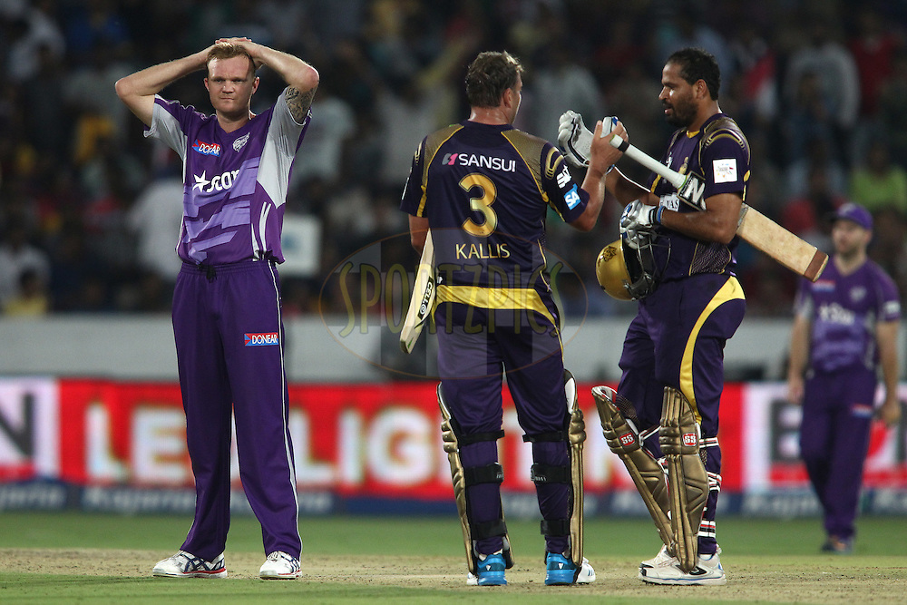 A dejected Doug Bollinger of the Hobart Hurricanes looks on as Jacques Kallis of the Kolkata Knight Riders and Yusuf Pathan of the Kolkata Knight Riders celebrate as Kolkata Knight Riders beat Hobart Hurricanes to reach the final during the first semi final match of the Oppo Champions League Twenty20 between the Kolkata Knight Riders and the Hobart Hurricanes held at the Rajiv Gandhi Cricket Stadium, Hyderabad, India on the 2nd October 2014<br /> <br /> Photo by:  Shaun Roy / Sportzpics/ CLT20<br /> <br /> <br /> Image use is subject to the terms and conditions as laid out by the BCCI/ CLT20.  The terms and conditions can be downloaded here:<br /> <br /> http://sportzpics.photoshelter.com/gallery/CLT20-Image-Terms-and-Conditions-2014/G0000IfNJn535VPU/C0000QhhKadWcjYs