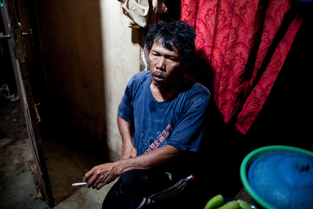 Abah Dayat rests after returning from collecting scraps from Citarum River.  Citeureup Village, Kabupaten Bandung...Credit: Andri Tambunan for Greenpeace