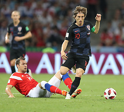July 7, 2018 - Sochi, Russia - ARTEM DZYUBA of Russia loses the ball to LUKA MODRIC of Croatia during the 2018 FIFA World Cup quarter-final match between Russia and Croatia. Croatia won 4-3 in penalty kicks. (Credit Image: © Cao Can/Xinhua via ZUMA Wire)