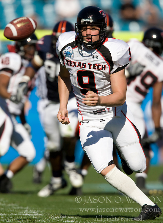 Texas Tech punter Jonathan LaCour (9) reacts after the ball is snapped over his head on a punt attempt.  The Texas Tech Red Raiders defeated the Virginia Cavaliers 31-28 in the 2008 Konica Menolta Gator Bowl held at the Jacksonville Municipal Stadium in Jacksonville, FL on January 1, 2008.