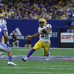 Sep 2, 2017; New Orleans, LA, USA; LSU Tigers running back Derrius Guice (5) runs against the Brigham Young Cougars during the first quarter of the AdvoCare Texas Kickoff game at the Mercedes-Benz Superdome. Mandatory Credit: Derick E. Hingle-USA TODAY Sports