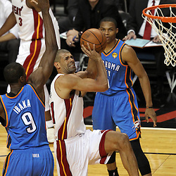 Jun 19, 2012; Miami, FL, USA; Miami Heat small forward Shane Battier (31) drives to the basket against Oklahoma City Thunder power forward Serge Ibaka (9) during the first quarter in game four in the 2012 NBA Finals at the American Airlines Arena. Mandatory Credit: Derick E. Hingle-US PRESSWIRE