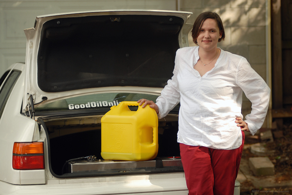 5/16/07 5:24:24 PM -- Louisville, KY, U.S.A..After converting her 1998 Diesel Volkswagen Jetta to a dual-fuel system, Maria Allison fills the 12.5 gallon tank in the trunk with discarded vegetable oil filtered in the garage...Photo by Brian  Bohannon , Freelance.