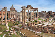 The Roman Forum with Temple of Saturn and the Arch of Septimius Severus in Rome, Lazio, Italy, as seen from Capitol Hill. In the background the Coliseum.