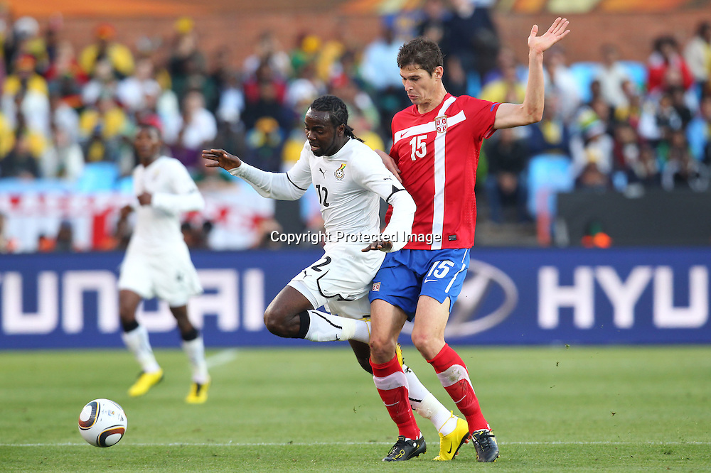 (L to R) <br /> Prince Tagoe (GHA), <br /> Nikola Zigic (SRB), <br /> JUNE 13, 2010 - Football : <br /> 2010 FIFA World Cup South Africa <br /> Group Match -Group D- <br /> between Serbia 0-1 Ghana <br /> at Loftus Versfeld Stadium, Pretoria, South Africa. <br /> (Photo by YUTAKA/AFLO SPORT) [1040]