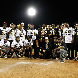 May 17, 2011; Metairie, LA, USA; New Orleans Saints players pose following the Heath Evans Foundation charity softball showdown featuring the offense versus the defensive players at Zephyrs Field.  Mandatory Credit: Derick E. Hingle