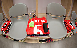 HAIFA, ISRAEL - Saturday, March 28, 2015: The shirt, captain's armband and black armband in memory of Dai Williams laid out for Wales' captain Ashley Williams in the dressing room ahead of the UEFA Euro 2016 qualifying Group B match against Israel at the Sammy Ofer Stadium. (Pic by David Rawcliffe/Propaganda)