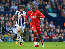 WEST BROMWICH, ENGLAND - Sunday, May 15, 2016: Liverpool's Christian Benteke in action against West Bromwich Albion's Claudio Yacob during the final Premier League match of the season at the Hawthorns. (Pic by David Rawcliffe/Propaganda)