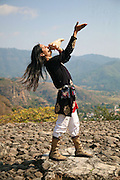 Indigenous Mexican blowing on a conch shell in Malinalco, Mexico
