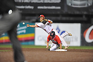 Louisiana-Lafayette's Jace Conrad (19) forces out Mississippi's Will Jamison (4) and throws to first for a double play in an NCAA Super Regional game in Lafayette, La. on Sunday, June 8, 2014. Mississippi won 5-2. (AP Photo/Oxford Eagle, Bruce Newman)