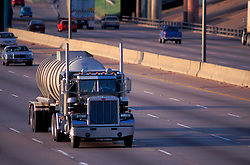 Large tanker truck driving on a Houston freeway