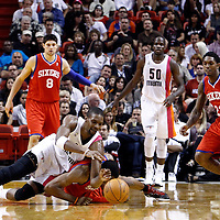 21 January 2012: Miami Heat power forward Chris Bosh (1) dives for the ball over Philadelphia Sixers forward Thaddeus Young (21) during the Miami Heat 113-92 victory over the Philadelphia Sixers at the AmericanAirlines Arena, Miami, Florida, USA.