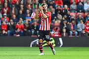 Manolo Gabbiadini (20) of Southampton appauds the fans as he walks off to be substituted during the Premier League match between Southampton and Chelsea at the St Mary's Stadium, Southampton, England on 7 October 2018.