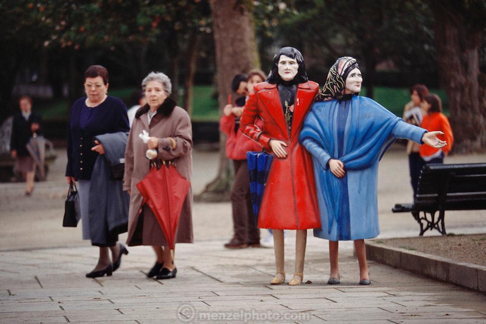 Lifelike statues in a city park, Santiago de Compostela, Spain.