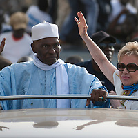 Abdoulaye Wade with his wife Viviane Wade greets supporters on February 22, 2012. The European Union urged Senegal today to lift a ban on street protests and urged all sides to end violence that has left several people dead in the run-up to a presidential election this weekend. Approval by the country's top court of 85-year-old President Abdoulaye Wade's bid to seek a third term, seen by the opposition as illegal, has sparked fierce protests in the capital Dakar. ©Sylvain Cherkaoui