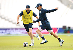 England's Chris Woakes (left) and Tom Curran during a training session at The Oval, London.