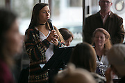 Olivia Dehm speaks at a rally that she helped organize at Spot Coffee, organized by Rochester Circle for Peace, in Rochester on Sunday, January 8, 2017.