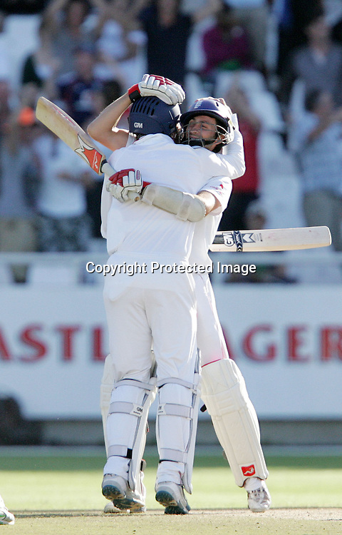 Graham Onions and Graeme Swann celebrate holding on to tie the test and make the series impossible to lose during the 5th day of the third test match between South Africa and England held at Newlands Cricket Ground in Cape Town on the 7h January 2010.Photo by: Ron Gaunt/ SPORTZPICS