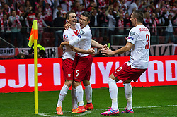 14.10.2014, Nationalstadium, Warsaw, POL, UEFA Euro Qualifikation, Polen vs Schottland, Gruppe D, im Bild Krzysztof Maczynski poland #16 radosc po gol bramka Waldemar Sobota poland #5 Artur Jedrzejczyk poland #3 // Krzysztof Maczynski poland #16 joy after goal celebrates after scoring goal Waldemar Sobota poland #5 Artur Jedrzejczyk poland #3 // during the UEFA EURO 2016 Qualifier group D match between Poland and Scotland at the Nationalstadium in Warsaw, Poland on 2014/10/14. EXPA Pictures © 2014, PhotoCredit: EXPA/ Newspix/ Sebastian Borowski<br /> <br /> *****ATTENTION - for AUT, SLO, CRO, SRB, BIH, MAZ, TUR, SUI, SWE only*****