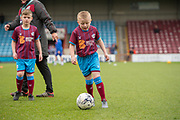 Junior Scunthorpe United player and mascots have a kick about prior to the EFL Sky Bet League 1 match between Scunthorpe United and Rotherham United at Glanford Park, Scunthorpe, England on 10 February 2018. Picture by Craig Zadoroznyj.