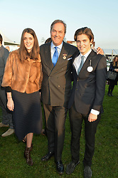 Left to right, CHLOE HERBERT, her father the HON.HARRY HERBERT and WILL HERBERT at the 2014 Hennessy Gold Cup at Newbury Racecourse, Newbury, Berkshire on 29th November 2014.  The Gold Cup was won by Many Clouds ridden by Leighton Aspell.