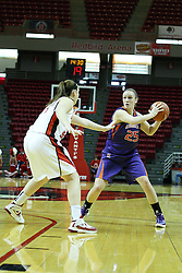 01 January 2012:  Samantha Heck pulls the ball back to protect it from Marley Hall during an NCAA women's basketball game between the Evansville Purple Aces and the Illinois Sate Redbirds at Redbird Arena in Normal IL